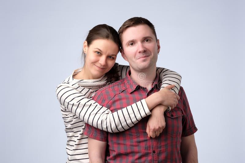 Young european couple standing against white gray background stock photos