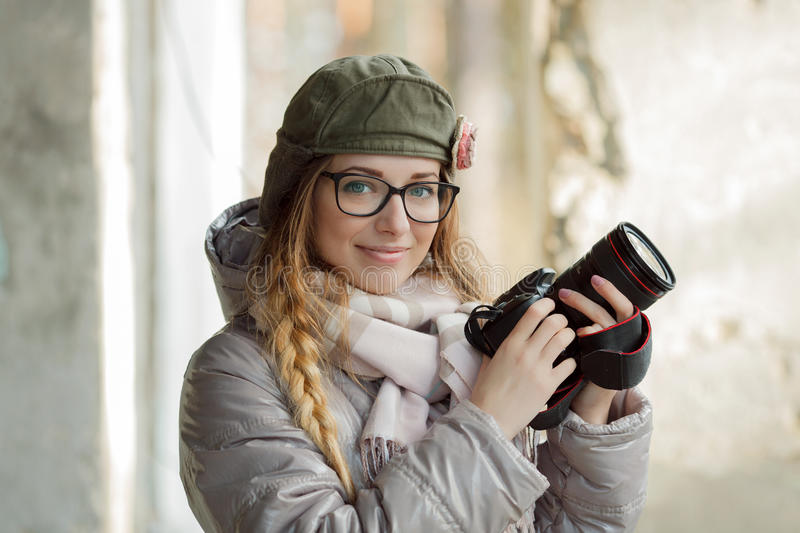 Young european woman photographer enjoying first spring sun exploring suburban locations royalty free stock photo