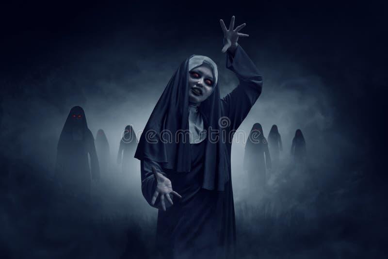 Young evil asian woman nun stock images