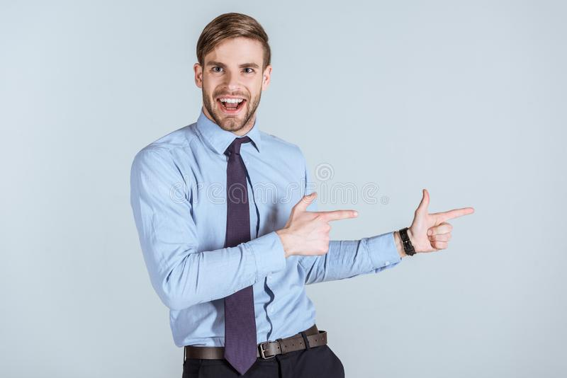 Young excited businessman pointing  royalty free stock photos