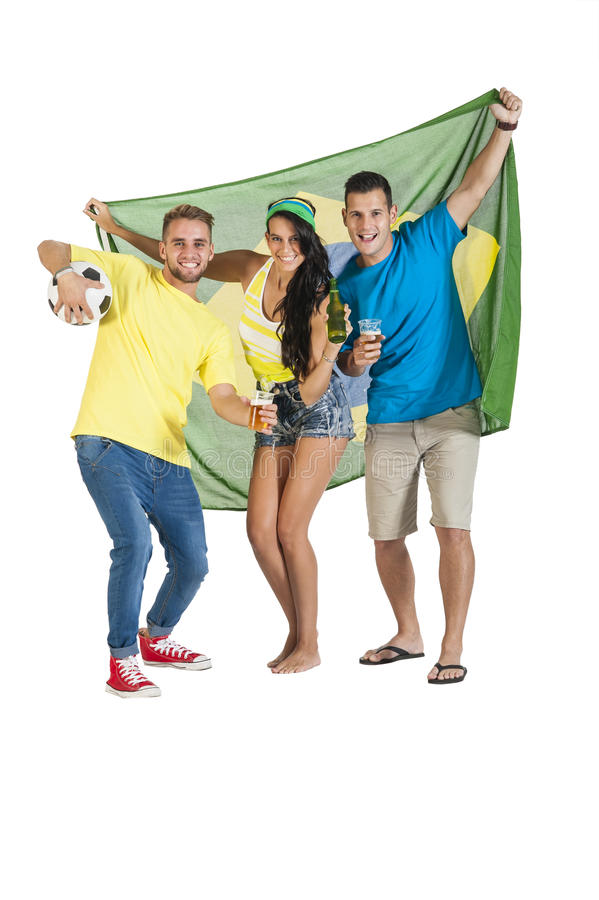 Young excited group of Brazil supporters with football. And drinks stock photo