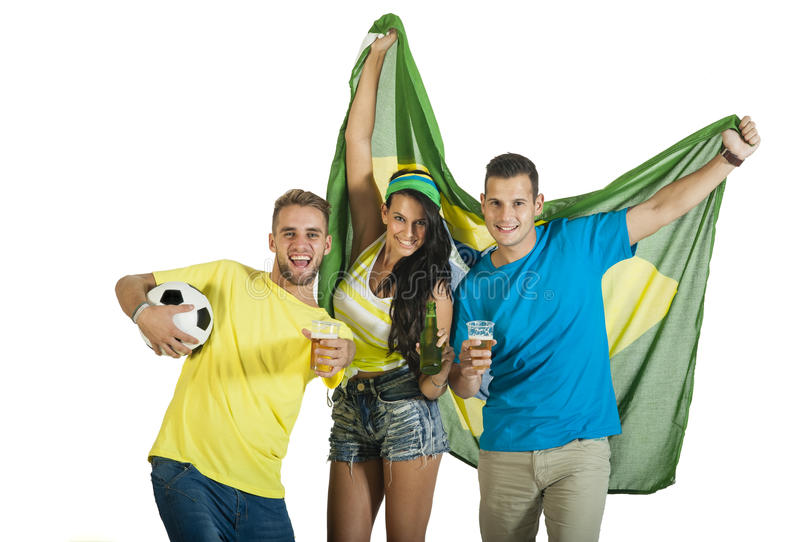 Young excited group of Brazil supporters with football. Young excited group of Brazil supporters with Brazil Flag, football and beers stock images
