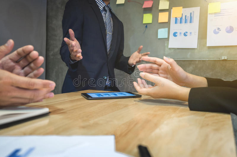 Young excultive manager presenting whiteboard and colleagues ap royalty free stock images