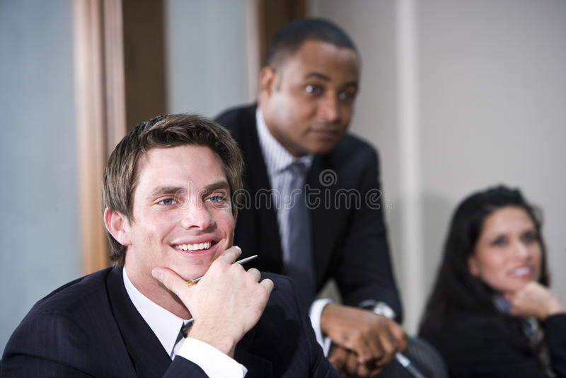 Young executive with colleagues royalty free stock image