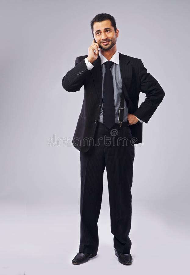 Young Executive Talking On the Phone royalty free stock photos