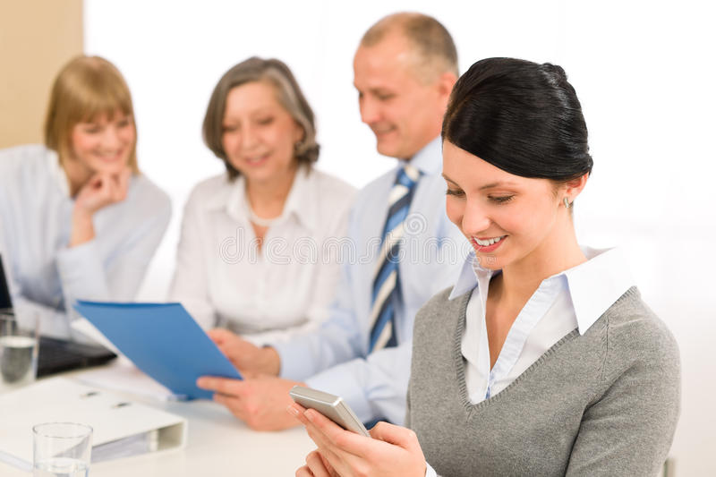 Download Young Executive Woman Use Phone During Meeting Stock Image - Image: 23256099