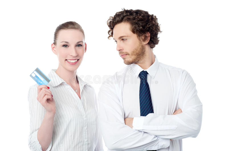 Young executives posing over white. Female executive showing her new credit card royalty free stock photo