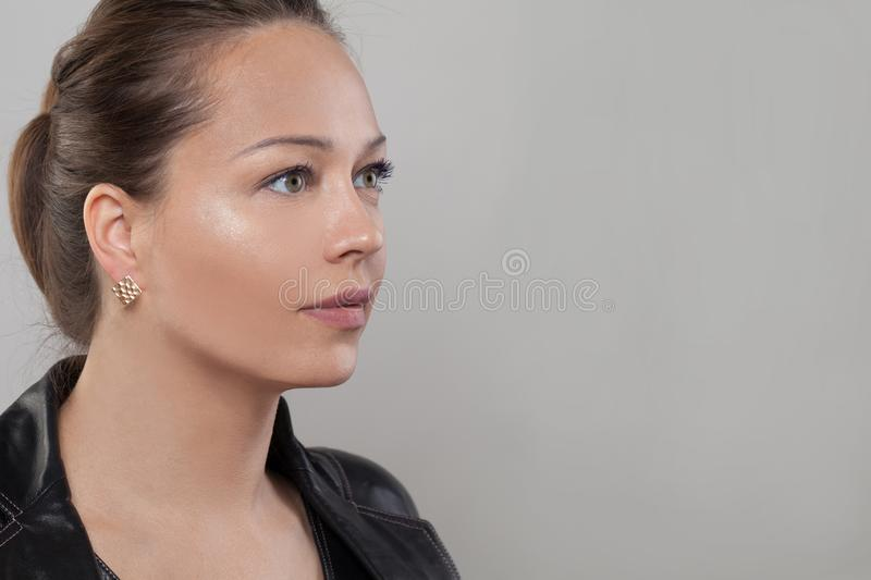 Young face. Healthy woman with natural skin, profile.  royalty free stock photography