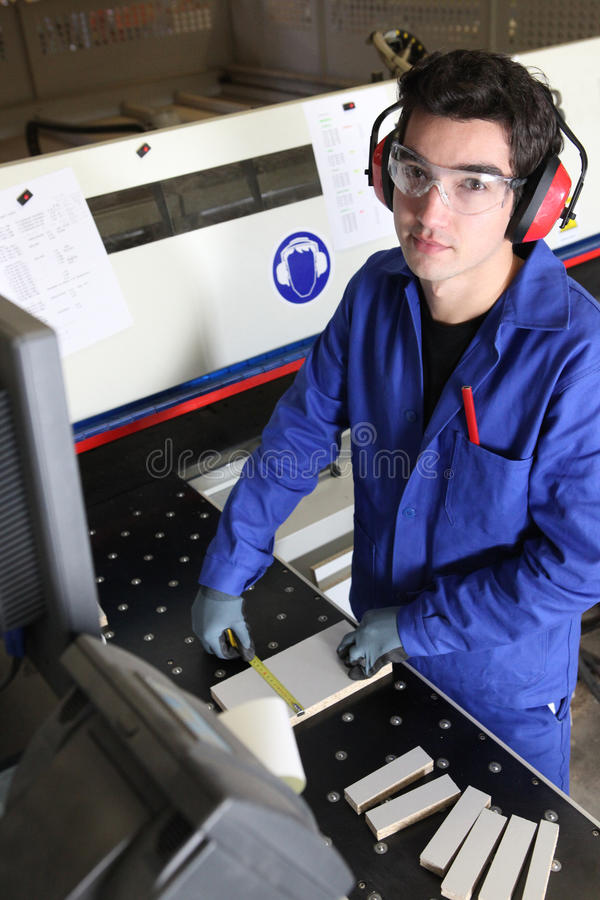 Young factory worker royalty free stock image