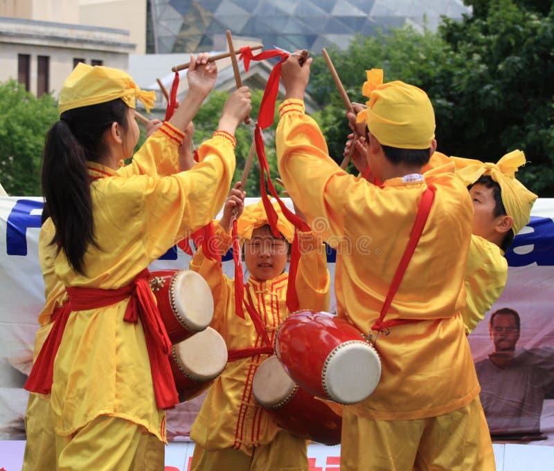 Young Falun Dafa Dance. OTTAWA, CANADA - JULY 1: Children demonstrating a Falun Dafa dance on Canada Day, July 1, 2012 in Ottawa, Ontario. Falun Dafa is a royalty free stock image