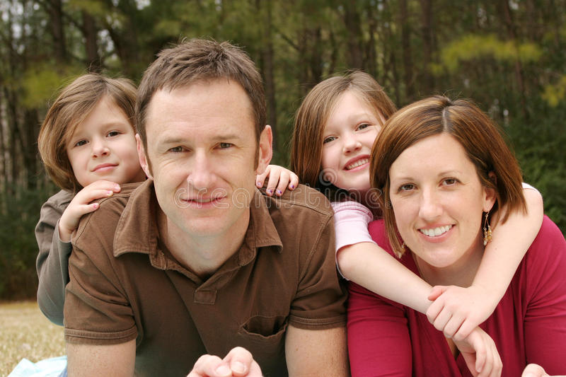 Young Family. Posing for a portrait stock photography