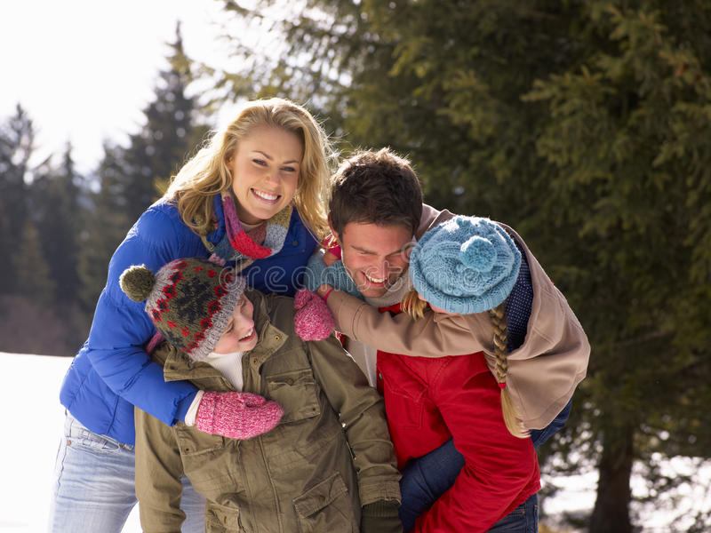 Young Family In Alpine Snow Scene royalty free stock image