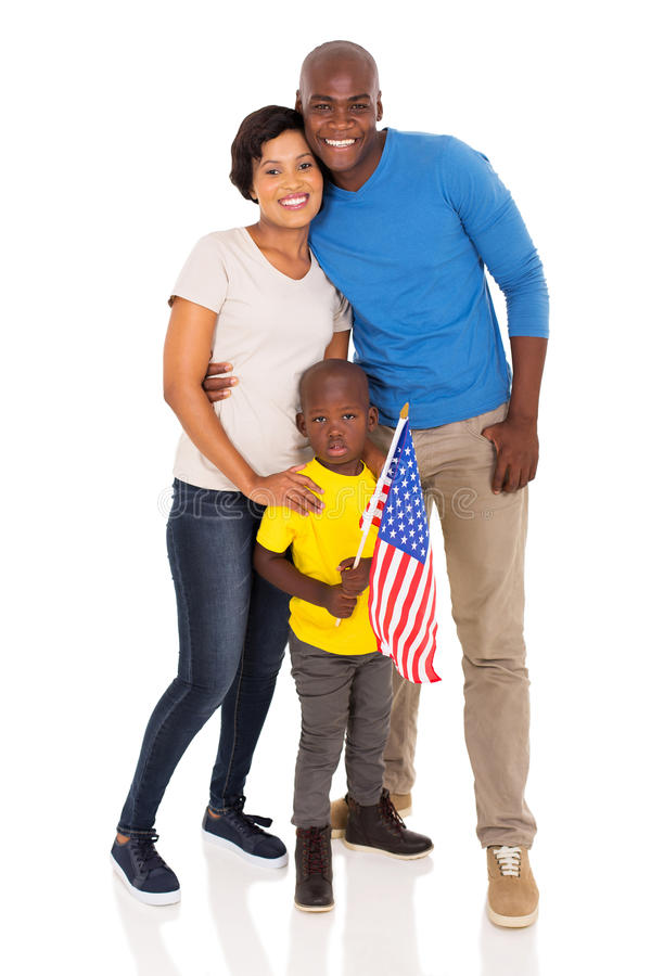 Young family american flag. Happy young family with american flag standing on white background royalty free stock photo