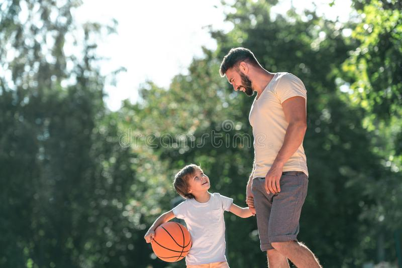 Young family with a ball stock image