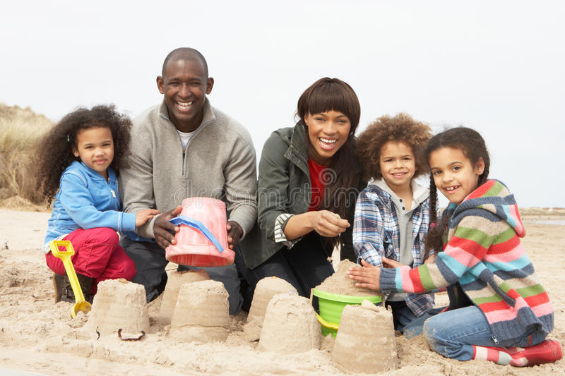 Young Family Building Sandcastle On Beach Holiday Royalty Free Stock Image