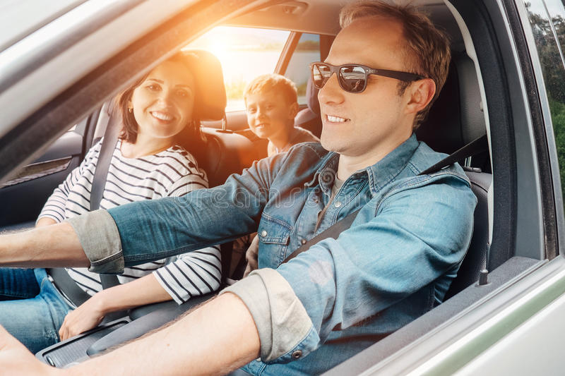 Young Family into the car during travel royalty free stock photos