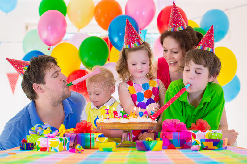 Young Family Celebrating Birthday Party Stock Photo