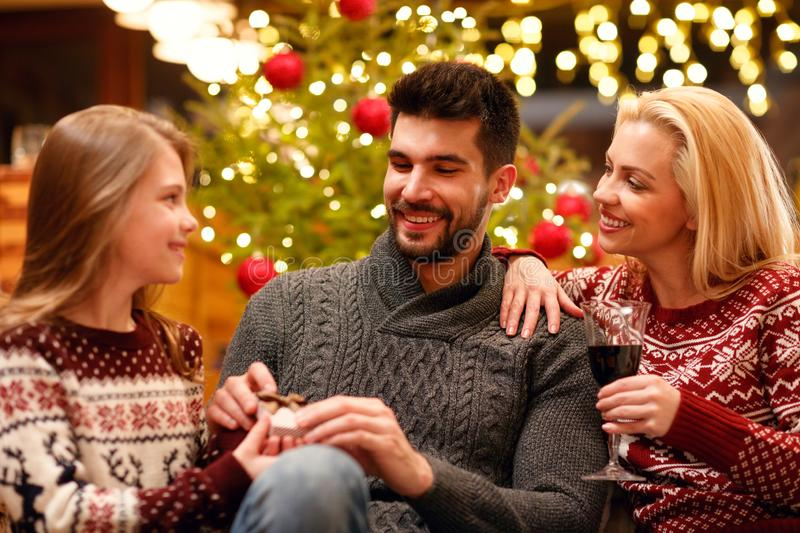 Young family celebrating Christmas at home stock photo