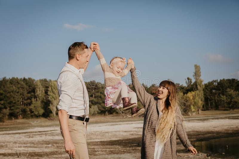 Young family with children having fun outdoor royalty free stock images