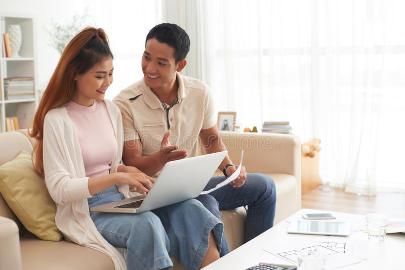 Young Family Choosing New House Online royalty free stock images