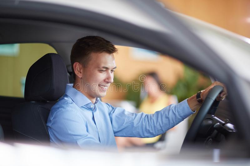 Handsome man. New auto business, sale, family and people concept. stock photos