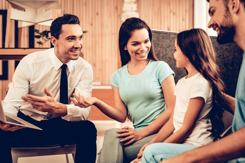 Young Family Consulting With Furniture Seller stock images