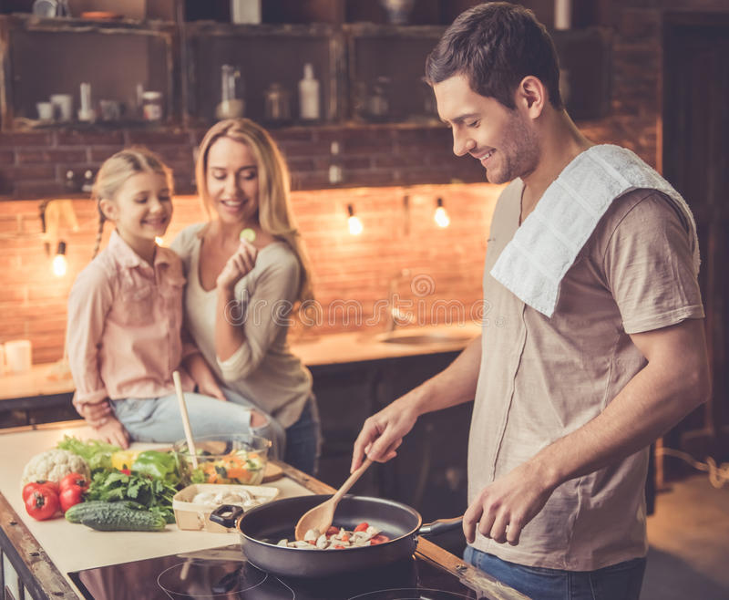 Young family cooking royalty free stock image