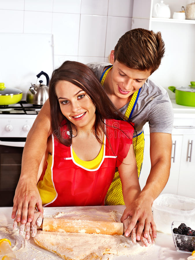 Download Young Family Cooking At Kitchen. Stock Photo - Image of adult, male: 38714100