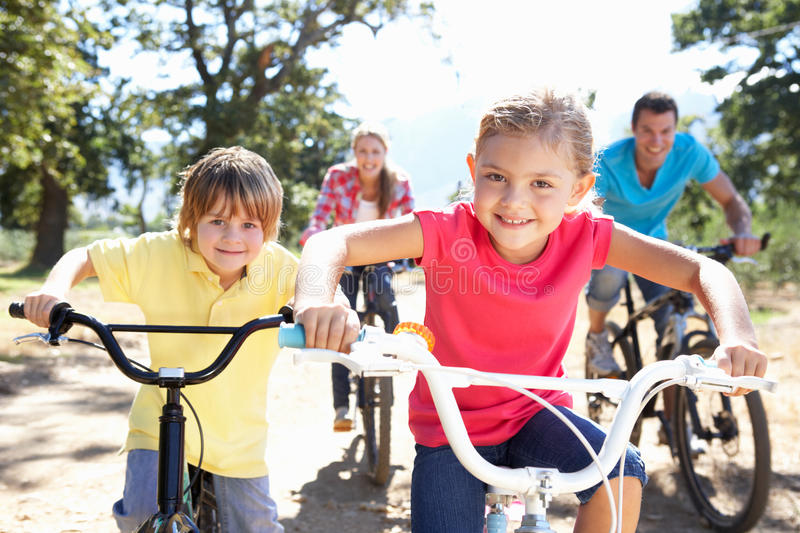 Young family on country bike ride stock photography
