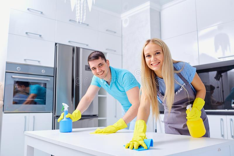 Young family couple doing cleaning in the house. Home cleaning stock photo