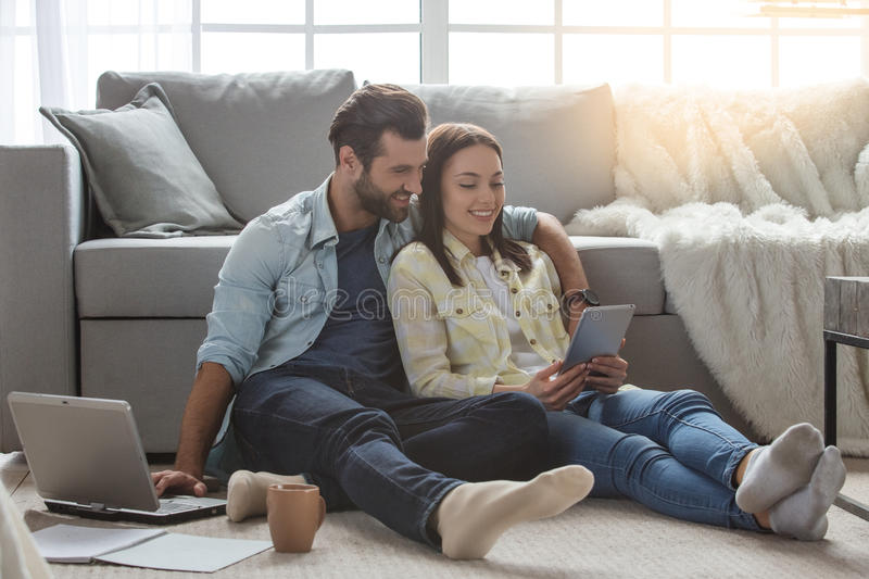 Young family couple together at home casual stock photo