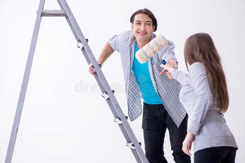 Young family doing renovation at home stock photography