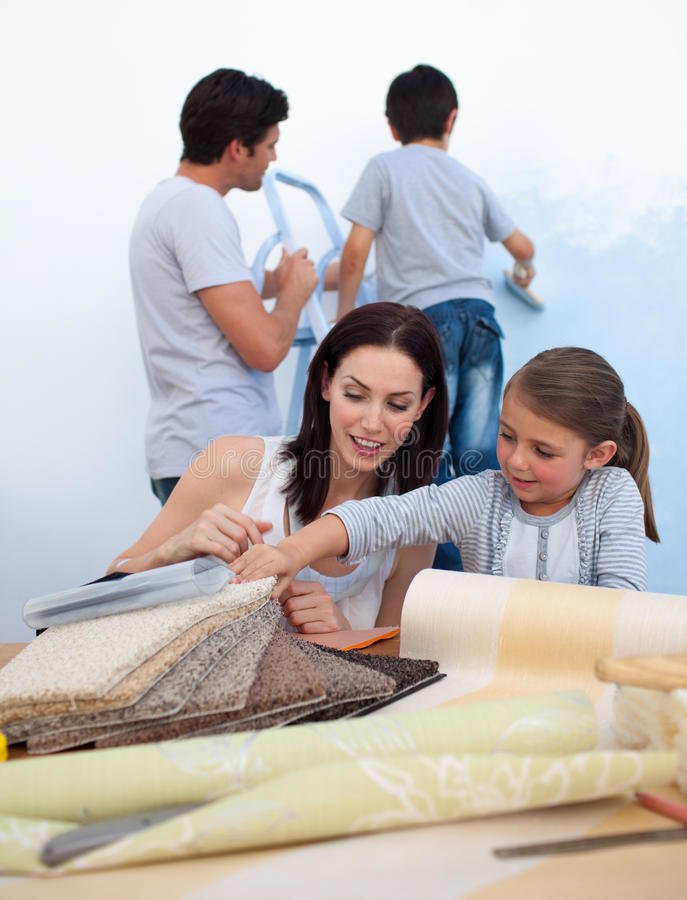 Download Young Family Doing Up Their New Home Stock Image - Image of moving, cheerful: 11997393