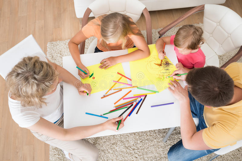 Young family drawing together with kids. At Home stock photos