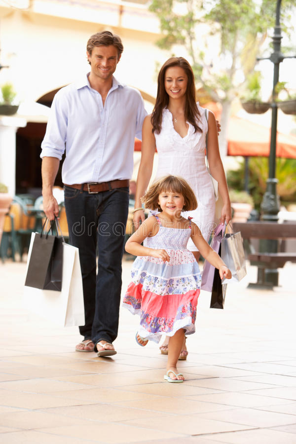Young Family Enjoying Shopping Trip royalty free stock image