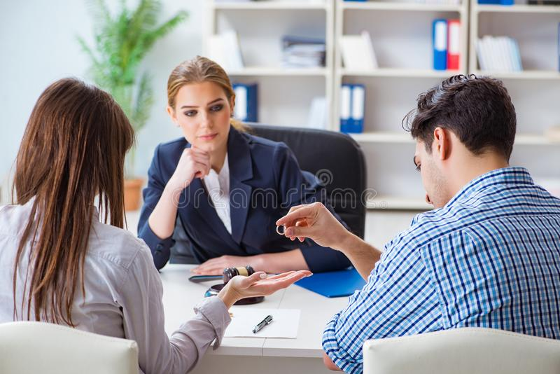 The young family filing divorce papers with lawyer stock images