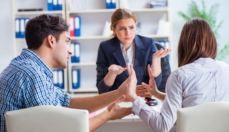 The young family filing divorce papers with lawyer. Young family filing divorce papers with lawyer royalty free stock image