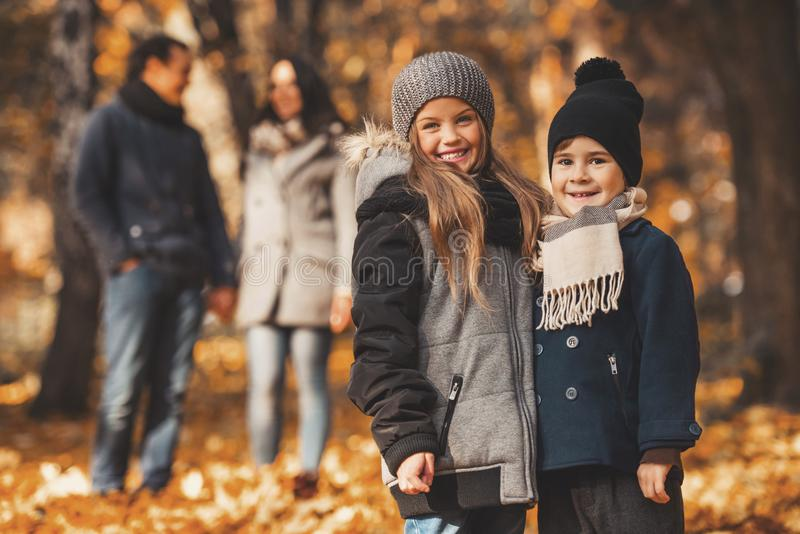 Young Family of Four Have Fun in Autumn Park. royalty free stock photo