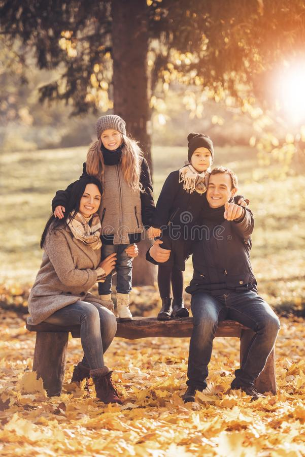 Young Family of Four Have Fun in Autumn Park. stock images