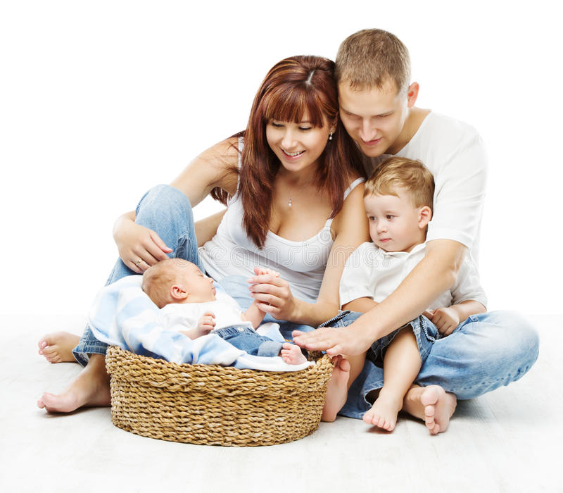 Young family four persons, smiling father mother two children. Young family four persons, smiling father mother and two children newborn sons, over white royalty free stock images