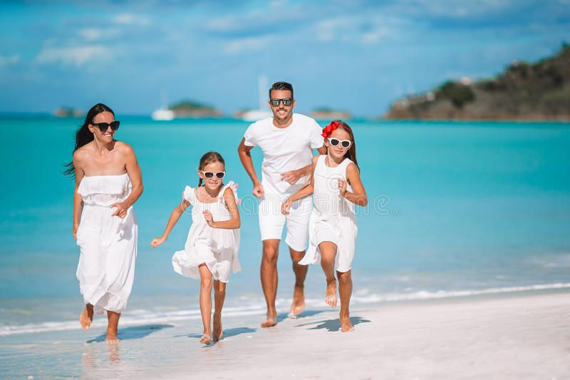 Young family of four on vacation have fun royalty free stock image