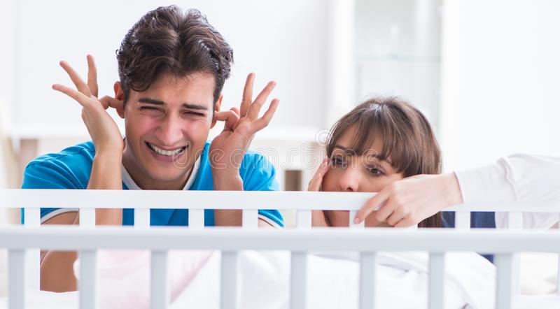 Young family frustrated at baby crying royalty free stock photography