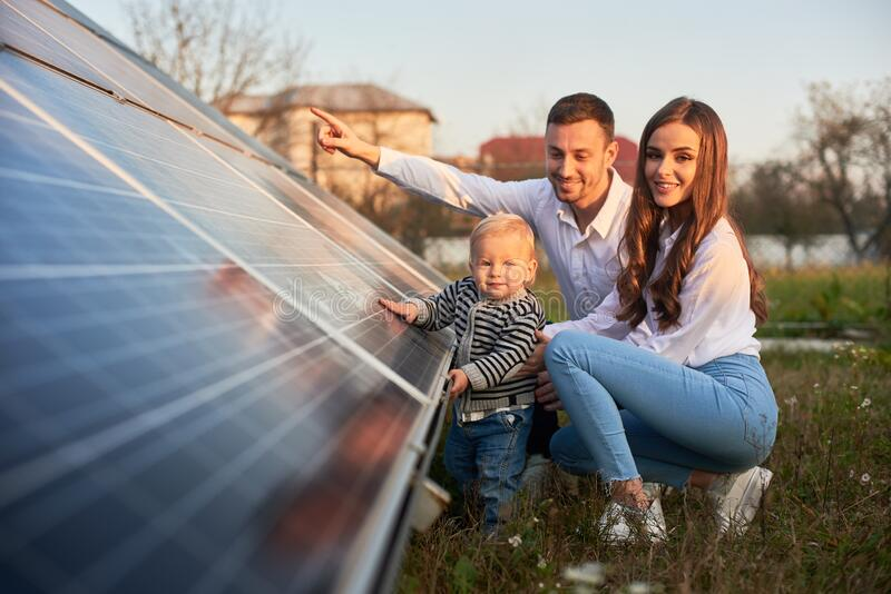 Young family getting to know alternative energy royalty free stock image