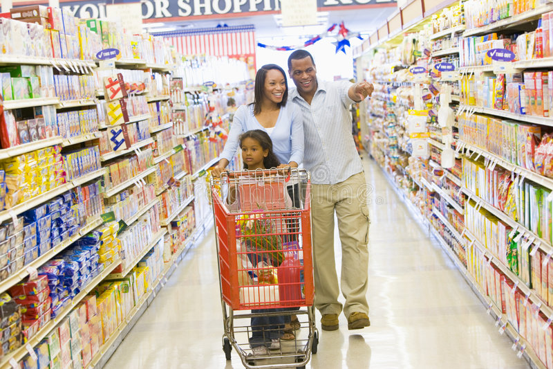 Young family grocery shopping royalty free stock photo