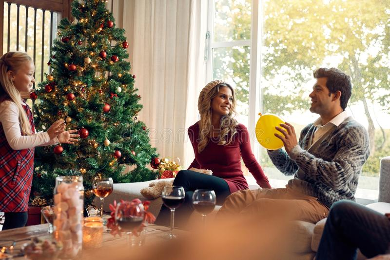 Young family having fun at home during christmas stock photography