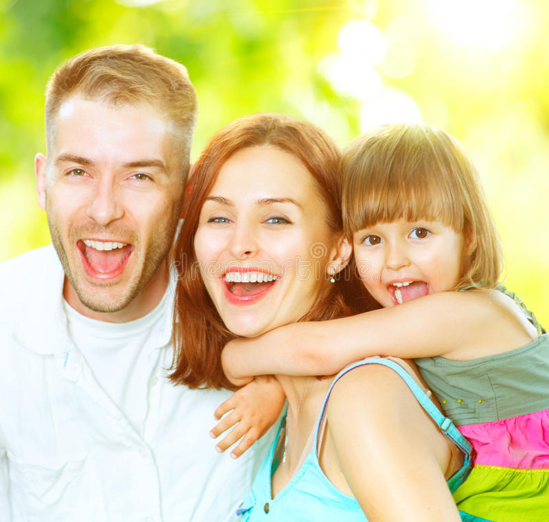 Young family having fun outdoors. Happy joyful young family having fun outdoors royalty free stock photo