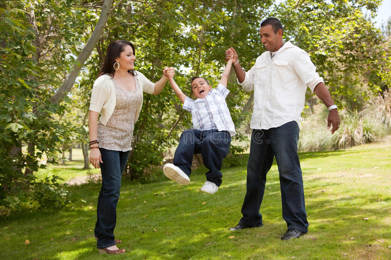 Young Family Having Fun in the Park stock image
