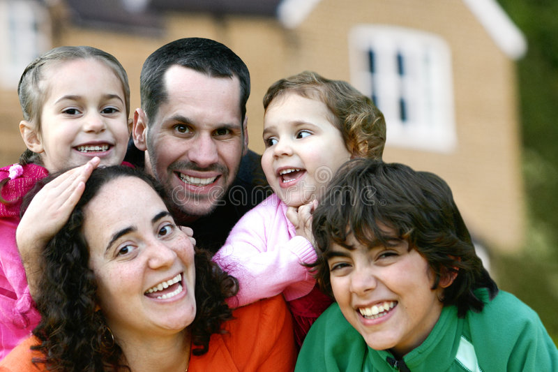 Young family having fun playing stock image