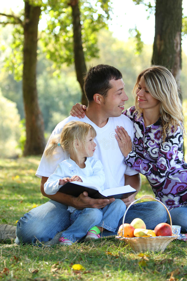 Young family having a picnic in nature. A Young family having a picnic in nature royalty free stock photo