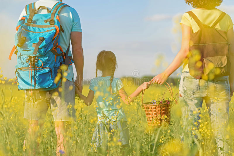 Young family hiking on mountain stock photo